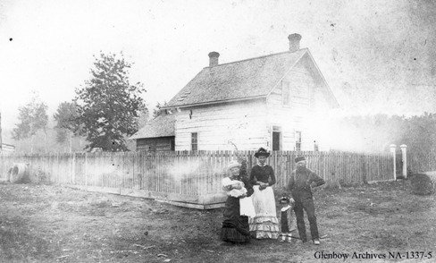 John Walter and family in front of their house
