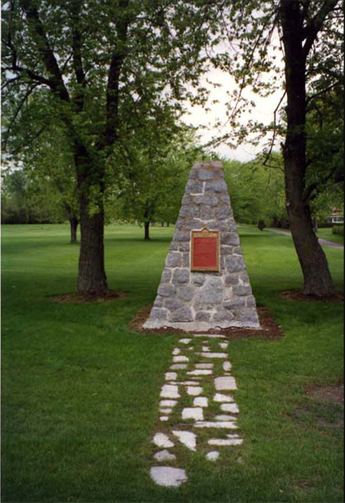 Photo of plaque and cairn